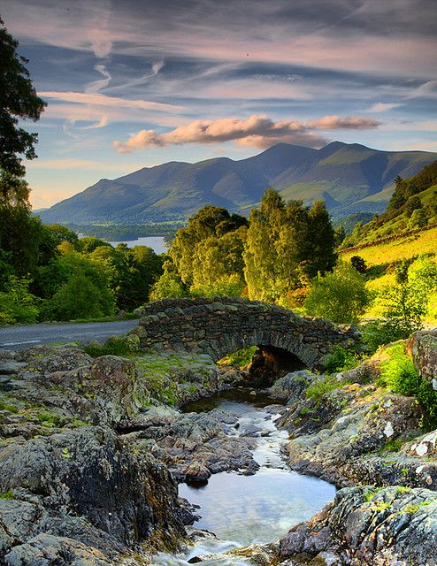 https://flic.kr/p/4VzE4W | A Shady Bridge. | I felt I had to post this photo even though the light on the bridge was wrong.. the clouds over the distant hills, for me, made it worth while.  The bridge is Ashness Bridge, the background mountains/hills are Skiddaw.