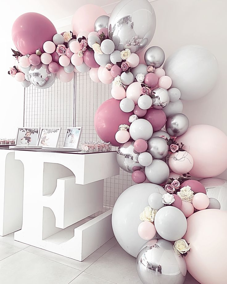 Pretty pink, grey and silver balloon garland for a first