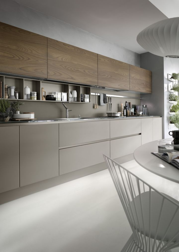 Modern style kitchen cabinets with coloured base units and timber fronted wall units. Subtle, simple and effective.