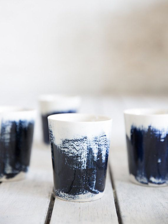 created in slip casting technique and finished with a shiny glaze. Each cup has a unique slip coloring by brush