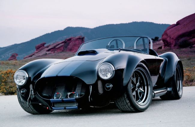 Stunning '65 #Shelby #Cobra Replica. Lu Stoddard's staggeringly detailed, five-year Cobra build may pay obvious visual homage to the flared and fearsome 427 S/C, circa 1965, but it also positively bristles with the power and civility afforded by new-millennium technology.  Read more: http://www.mustangandfords.com/featured-vehicles/1407-1965-shelby-cobra-replica-snail-fed-serpent/#ixzz3GoSKyIEn