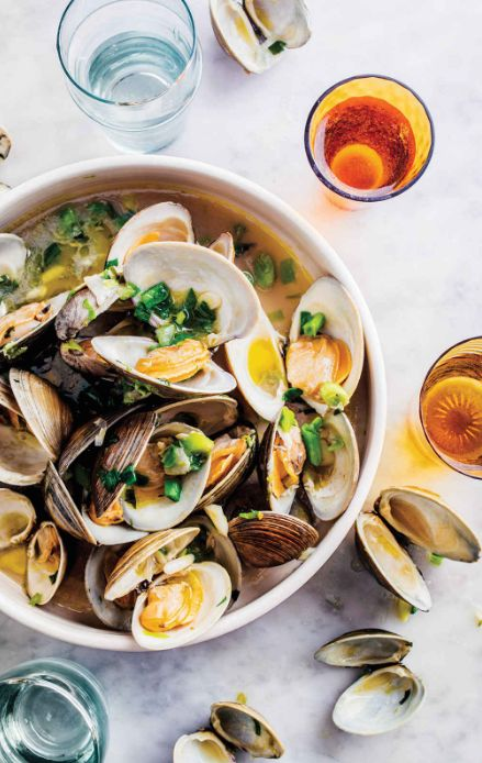 these yummy steamed clams are studded with spring herbs, via @goop