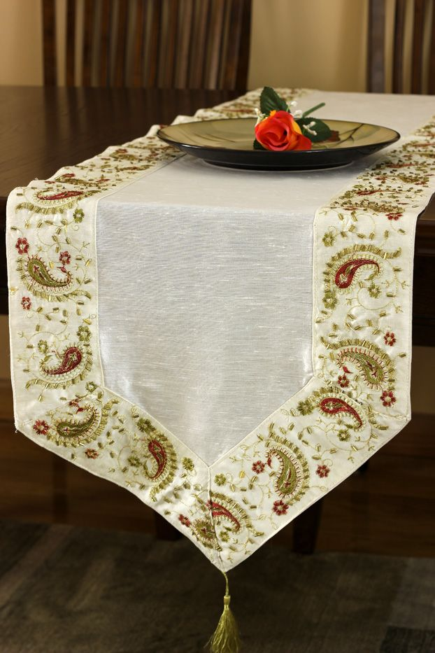 Breathtaking Border Is The Focal Point Of This Silky Table Runner, Giving  It A Classic