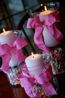 Cute baby shower centerpieces made of candles and candy. #BabyShowerCenterpieces
