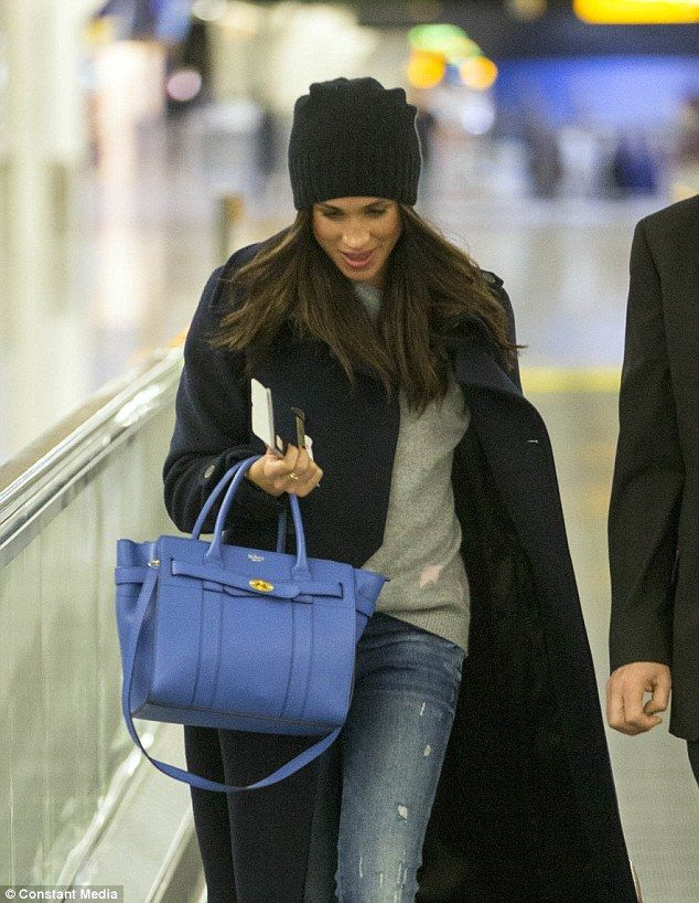 Maghan appeared to be in good spirits as she departed Heathrow after spending a week in Lo...