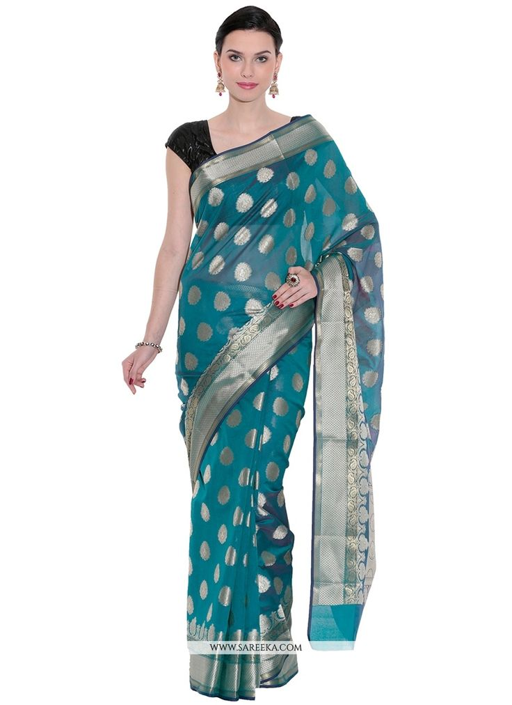 Bring out the true diva in you and reinvent your true self. Be your own style icon with captivating blue art silk classic designer saree. The brilliant attire creates a dramatic canvas with amazing we...