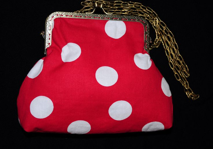 Red fabric with white dots. This  little bag is very pretty and  fashionable. There is fleece inside so it is well padded.Size: 15 X 19cm
