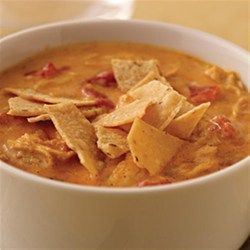 Cheesy Tortilla soup  A hearty, cheesy soup with diced tomatoes, shredded chicken, taco seasoning and lots of cheese, this soup will feed a hungry crowd and it's ready in 35 minutes.