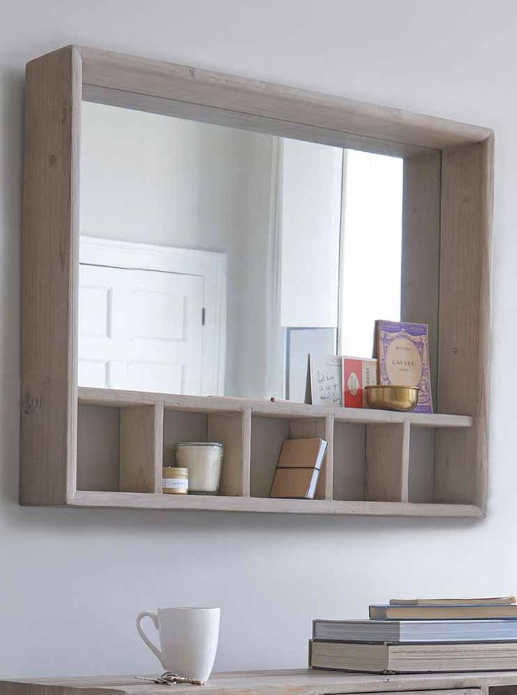 Behold, a mirror that actually does more than one thing! With cubby holes for stashing bits and bobs, we couldn't help but wonder… why doesn't every mirror have a shelf? mirror, mirrors, wall mirror, floor mirror, mirror homewares, interior, design, furniture, accessories, wall decor, round mirror, oval mirror, shelf mirror, storage mirror