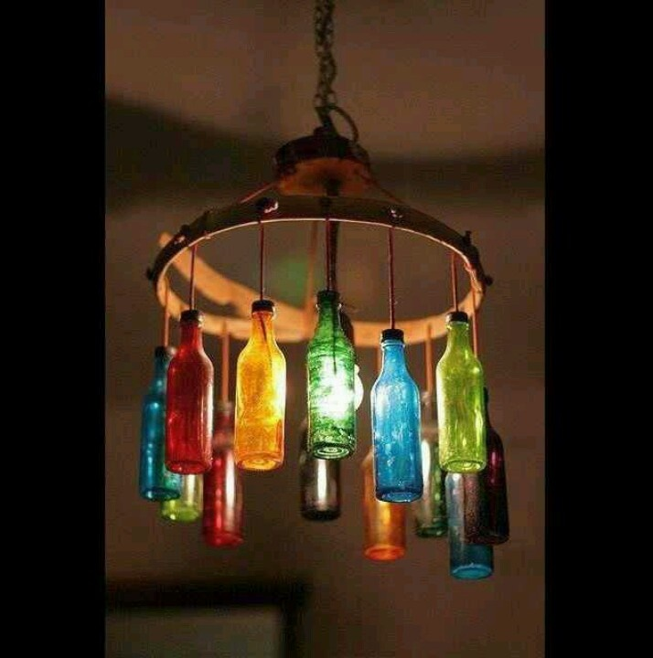 Colored glass bottle chandelier decorating ideas for Glass bottles with lights in them