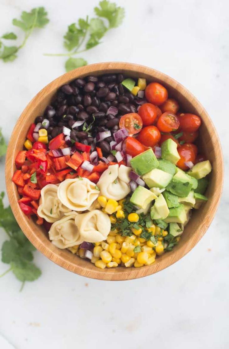 A fresh and easy southwest tortellini pasta salad that can be made in less than 30 minutes! It's loaded with veggies and protein and coated in a deliciously simple and healthy southwest dressing.   Tastes Better From Scratch
