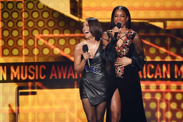 Kat Graham Photos - Kat Graham (L) and Kelly Rowland speak onstage during the 2017 American Music Awards at Microsoft Theater on November 19, 2017 in Los Angeles, California. - Kat Graham Photos - 54 of 2839