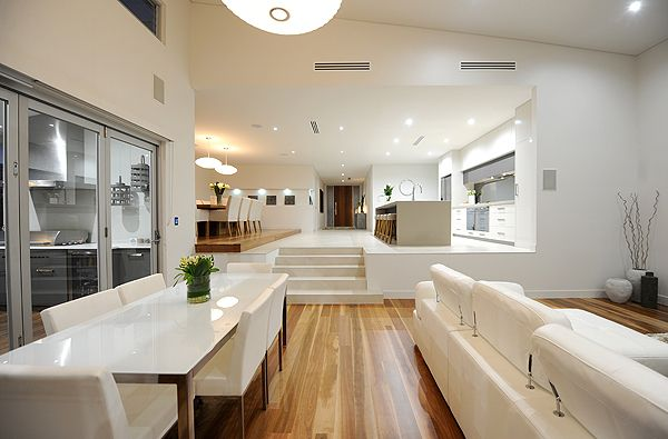 The furniture and decor is a bit too clean cut for us but we love the idea of the split levels. One option we're looking at is to have our kitchen like this at the upper level and then drop the extension as we have a suspended floor currently so there's an option of that.