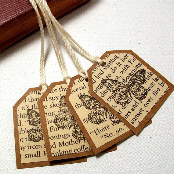 gift tags from book pages, stamped with butterfly