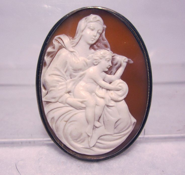 """19th Century Carved Sardonyx Shell Cameo Mother & Child Signed """"L"""" on Reverse $339 A hand carved Sardonyx Shell Cameo with a depiction of a mother and child. The carving is Excellent and nicely detailed, done by a talented artisan. The dark colored Sardonyx shell is the rarest of shell cameo materials. The cameo is mounted as a pin or a pendant. 19th Century and probably Italian. CONDITION: Excellent Condition. I don't see ANY nicks, chips or cracks and no repairs. SIZE: The cameo includ"""