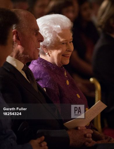 Queen Elizabeth II and the Duke of Edinburgh listen to poetry readings during a Reception for Contemporary British Poetry at Buckingham Palace, London.