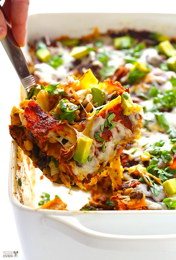 "This chicken enchilada casserole recipe (a.k.a. ""stacked chicken enchiladas"") is simple to make, gluten-free and vegan-adaptable, and CRAZY delicious!"