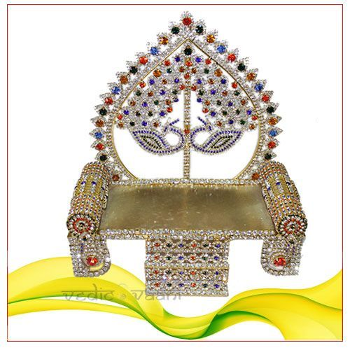 Peacock deity throne get fare rate at world wide from vedicvaani.com, Hurry Up now...  Peacock deity throne  Be the first to review this product  Auspicious throne for your deity with motifs of peacock in the center.  Two cushions, stairs and a broad seat adds to its elegance. Its unique design will be a value addition to your altar.  Dimensions:  6.5  inches (L) x 3  inches (W) X  7.5 inches (H)  Weight: 370 grams