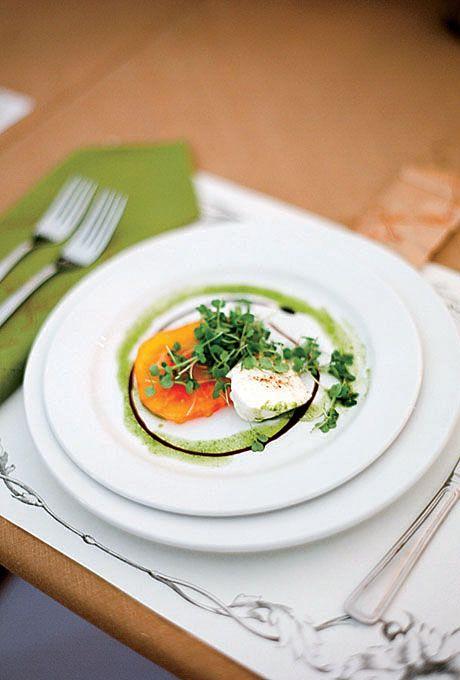 A tomato-and-mozzarella salad was garnished with baby arugula.