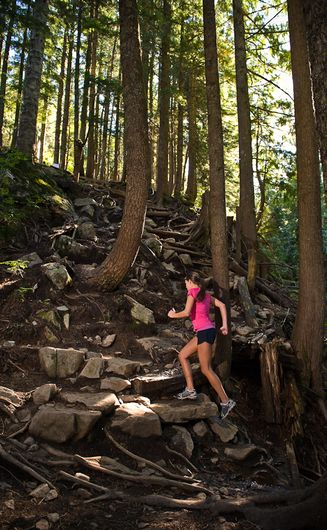 """The Grouse Grind Trail Facts: The Grouse Grind® is a 2.9-kilometre trail up the face of Grouse Mountain (Vancouver, Canada), commonly referred to as """"Mother Nature's Stairmaster."""" Length: 2.9 kilometres (1.8 miles) Elevation Gain: 853 metres (2,800 feet) Base: 274 metres above sea level (900 feet) Summit: 1,127 metres (3,700 feet) Total Stairs: 2,830"""