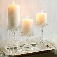 Turn crystal wineglasses upside down on a silver tray and use the bottoms as bases for pillar candles. Wrap a small beaded garland around the base of each candle for extra sparkle.