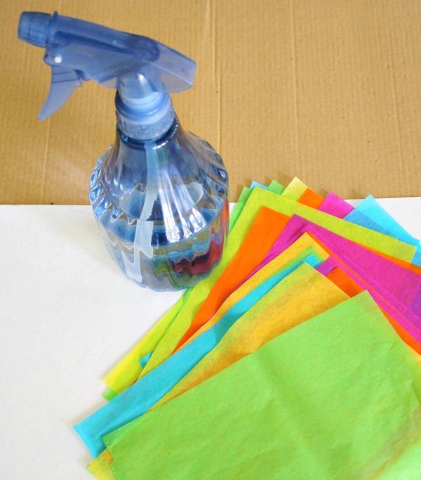 Set up an invitation to create with tissue paper and create beautiful art.