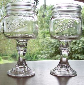 Funky redneck wine glasses....mason jars with candlestick holders as stems. Love it! I saw these at the local flea market... I told the seller that she missed her mark... fill these with candy- perhaps a dessert and give as gifts... use the pretty ball jars and put the tin lids on...
