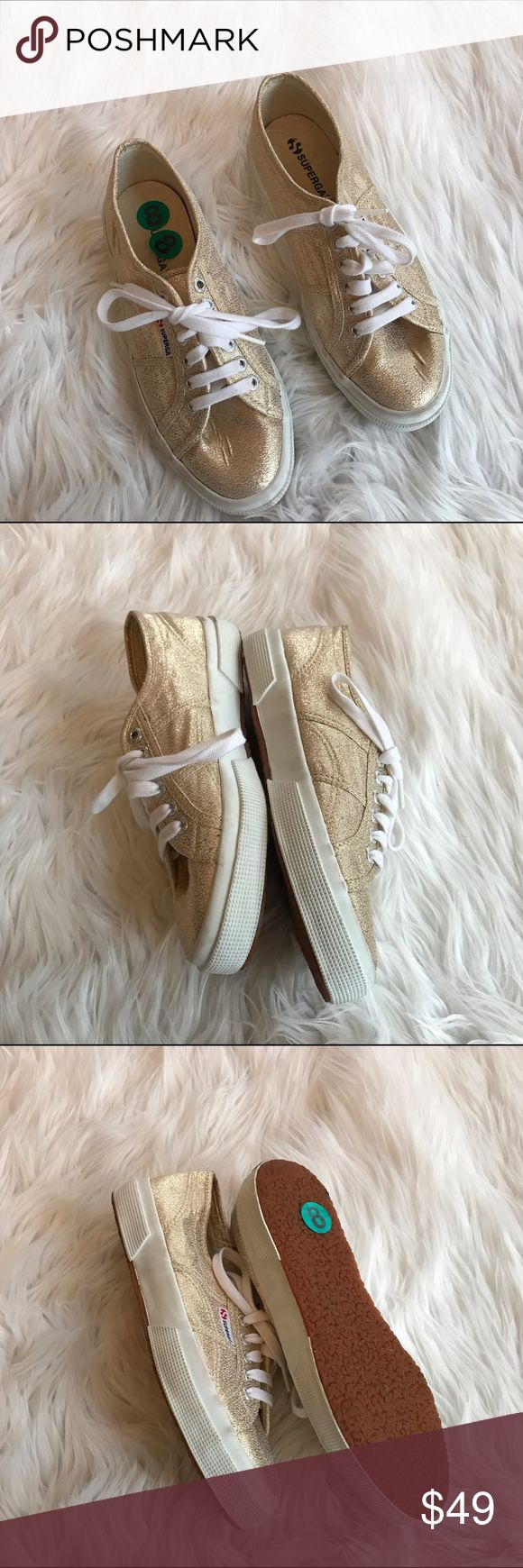 💙💙 GOLD TENNIS SHOES B14 These are currently in stores at Anthro. Does not come with original box Condition: EUC besides a little dirty on white sides  Material: canvas upper  Item location: bin 14   **bundles save 10%** no trades/no modeling/no asking for lowest Anthropologie Shoes Sneakers