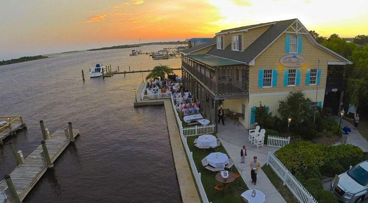 """Saltwater Grill located in downtown Swansboro, North Carolina. Saltwater Grill is in the heart of the """"Friendly City By the Sea""""  overlooking the Intracoastal waterway and Bogue Sound."""