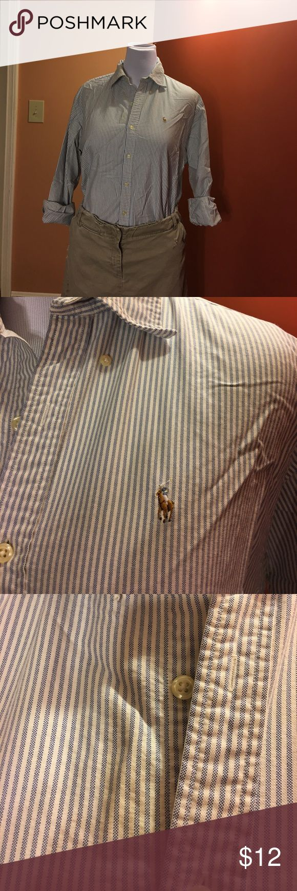 """Ralph Lauren polo oxford shirt Ralph Lauren women's oxford size 14. Blue and white pinstripe. Has a stain on the right side, picture included. Comes from a smoke and pet free home. Measures 23"""" from armpit to armpit. Polo by Ralph Lauren Tops Button Down Shirts"""