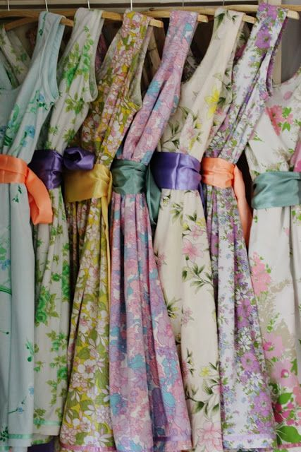 vintage sheets made into simple dresses. The bright ribbon sash's make all the difference! Click pic for link to appreciate.