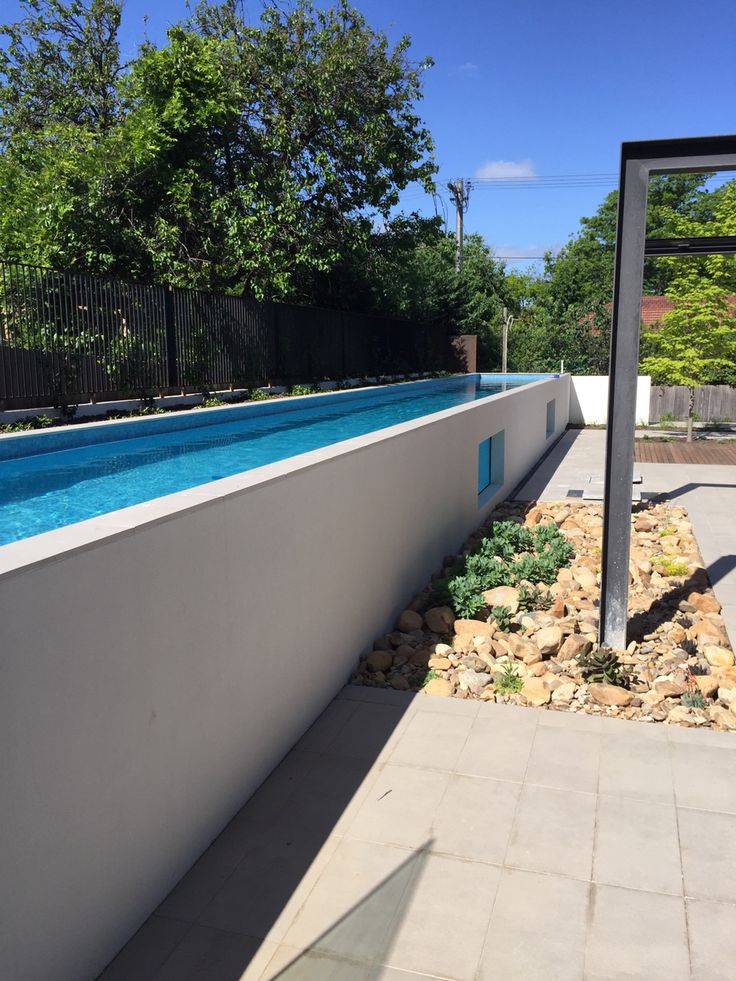 Side of above ground lap pool - 1.2m height means you do not need pool safety fence on the side. Solar Remco motorised cover to help heat and save water evaporation.