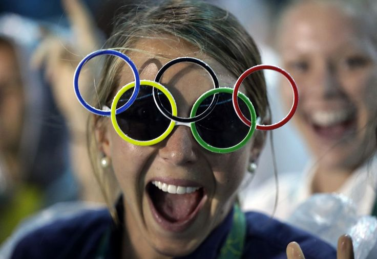 <p>Jackie Briggs from the United States wears the Olympic ring sunglasses…