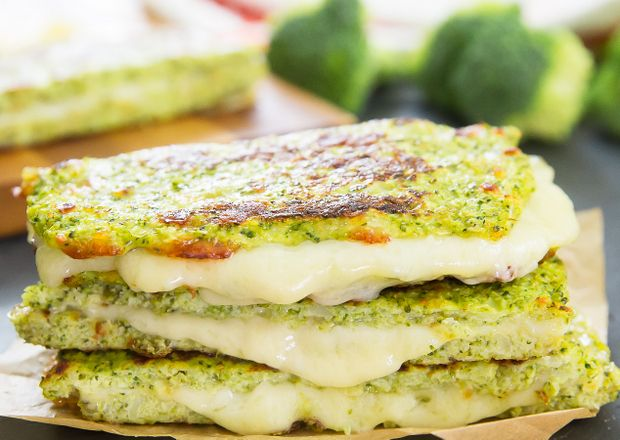 """This low carb, gluten free broccoli """"bread"""" is derived from my broccoli pizza crust and works wonderfully for grilled cheese sandwiches. The combination of melted cheddar cheese and broccoli reminds me of my childhood. It is also a great way to get some extra servings of vegetables in your body too. I've made cauliflower crusted …"""
