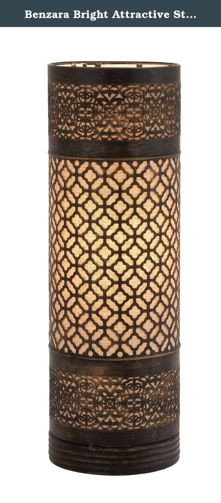 Benzara Bright Attractive Styled Metal Cylinder Table Lamp. Brighten up your space by adding this cylinder table lamp. The table lamp is cylindrical shaped made of quality metal that will last for years. This table lamp features brown designs amid of which you can add a candle of your choice and brighten up your space. The table lamp will steal the spotlight and flourish your ambience with lights. You can add this table lamp to your living space.