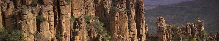 Dolerite pillars in Valley of Desolation: Formed hundreds of millions of years ago, the Karoo of South Africa is one of the great natural wonders of the world. Camdeboo National Park provides the visitor with insights into the unique landscape and ecosystem of the Karoo, not to mention awesome scenic beauty.    A unique feature of the 19 405-hectare park is its location, practically surrounding the town of Graaff-Reinet in the Eastern Cape.    The greater portion of the park is situated…