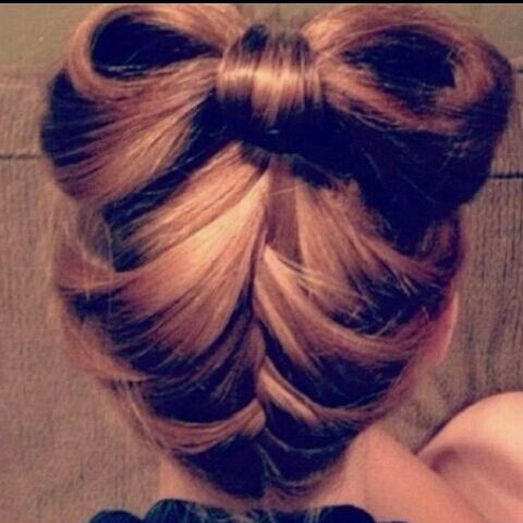 .French braid the bottom of a bun that has not been pulled all the way through. Separate your bun and pull the tail of your bun between the separated hair and pin in place. Voila hair bow.