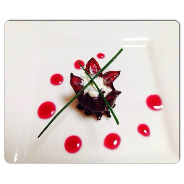 My dayghter's amuse-bouche.  Wild Hibiscus Flowers filled with Mascapone.