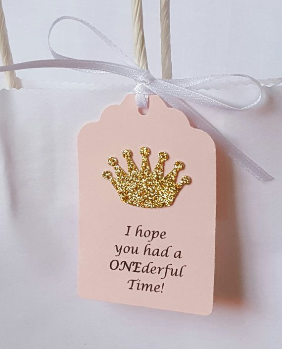 This adorable set of 12 princess favor tags measure 2.5 x 1.75, are made with pink cardstock adorned with a precious gold glitter crown and read I hope you had a ONEderful Time! then finished off with 12 white satin ribbon. Just imagine how amazing these tags will look tied to