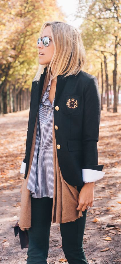 Jacey Duprie goes preppy, wearing a blue and white striped shirt from Each X Other, black school boy blazer from Smythe and a brown cashmere scarf from Cos