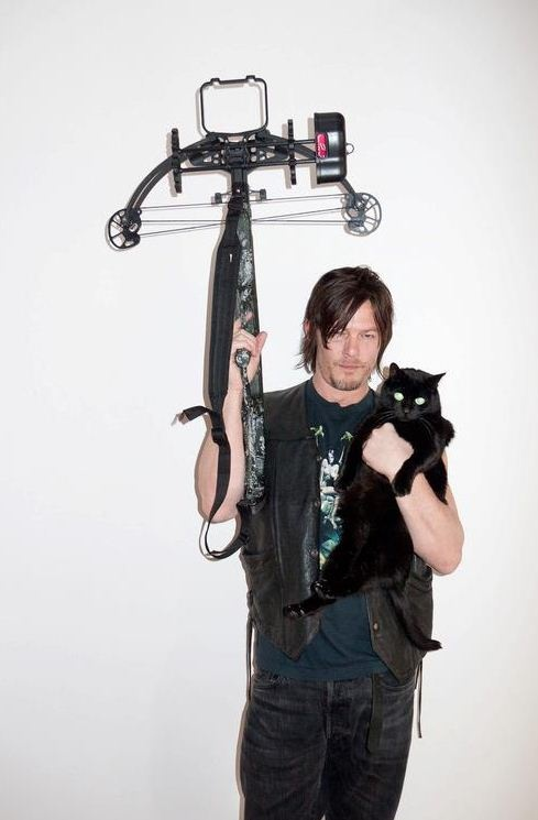 Two of my favorite things: Norman Reedus and a black cat!