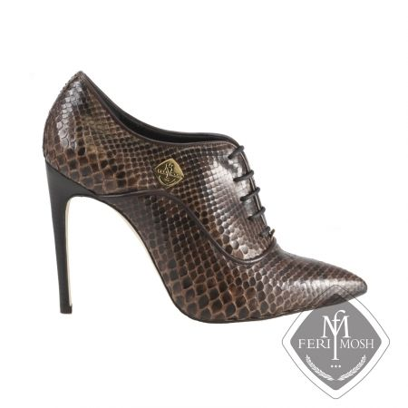 FERI MOSH - Aria Oxford - Stilettos Price                                  $2,826 Canadian Dollars Product #                           FMLS-5313 Product Category              FERI MOSH Opulence Wear - Deep brown genuine python oxford stiletto heels  - Made with genuine python uppers and lined with nappa leather and suede  - Real leather sole  - Quality stacked wood heel  - Metal plate with FERI MOSH logo on the outer side of both shoes - Lace up, oxford design  - FERI MOSH logo embossed…