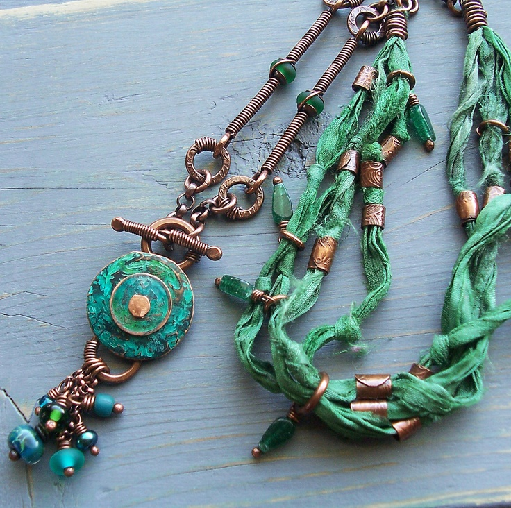 jungle green coin pendant copper metalwork lampwork glass and recycled sari silk and green gemstone