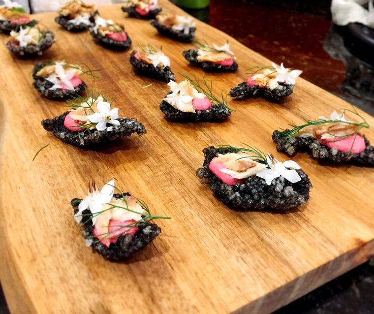 Squid ink tapioca crisp with beetroot hummus, smoked mackerel, fennel and borage flower. www.stevejamesltd.com #personalcook #personalchef #personaldining #privatechef #privatecook #privatedining #somerset #somersetcook #somersetfood #somersetchef #dorset #dorsetfood #dorsetchef #tapioca #squidink #squidinktapiocacrackers #beetroot #borageflower #chef #chef #summer #summerfood #canapes #party #henparty