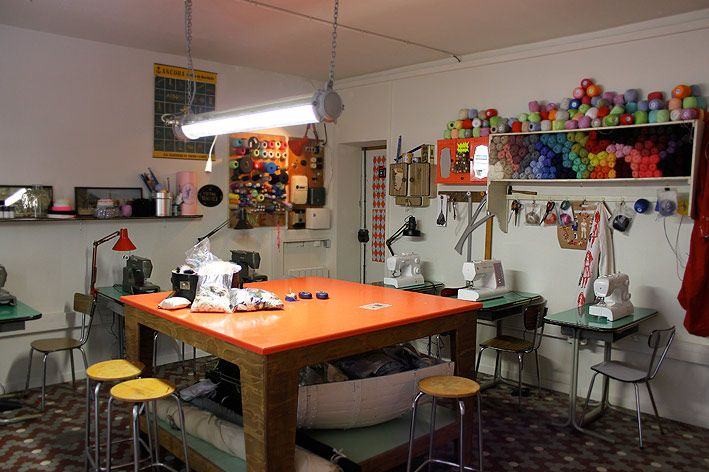 """""""Sweat Shop"""" in Paris. A place where people can come in, rent the sewing machines and work on making or re-doing their clothes. Sort of a cyber cafe with sewing machines. Great idea, great room. Ah..Paris"""
