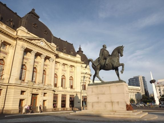 From left to right: the Central University Library of Bucharest, the equestrian statue of Carol I of Romania, and the Memorial of Rebirth - The place is located in Revolution Square, on Calea Victoriei (Victory Avenue) - Bucharest, Romania.