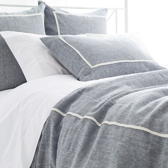 Pine Cone Hill Keaton Linen Indigo Duvet Cover. In a classic indigo and ivory combo, this linen chambray duvet cover, featuring a single pleat, is an easy, preppy piece with timeless appeal. Crafted to be an exact color match to our Hampton Ticking Linen Indigo duvet cover, shams, and decorative pillows.