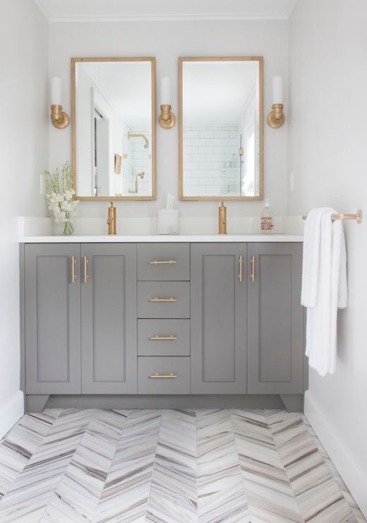 Effortlessly elegant bathroom design, especially with these gold metallic accents. Explore Liberty Hardware's polished and champagne bronze finishes for cabinet pulls, nobs, hooks and rails that will elevate your room's style and add a touch of warmth.