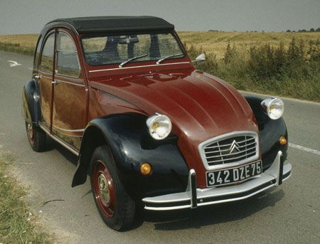 Citroen 2CV in the red and black paint scheme.  Another fun car that I intend to drive around in.  Fun, fun, fun!
