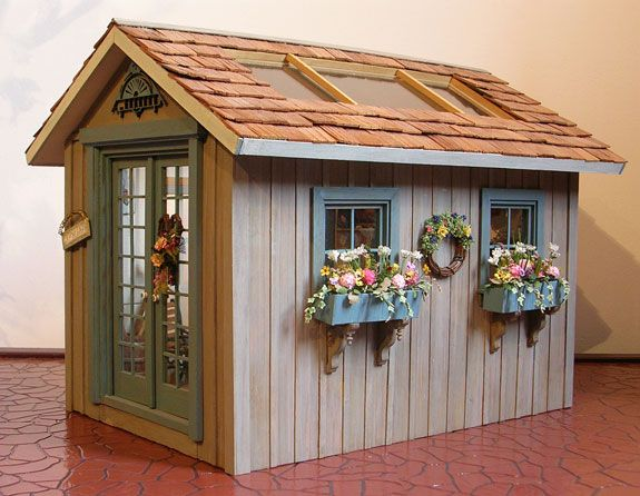 A lovely little miniature Garden Shed.  Want to make the roof of my playhouse lift off like this!